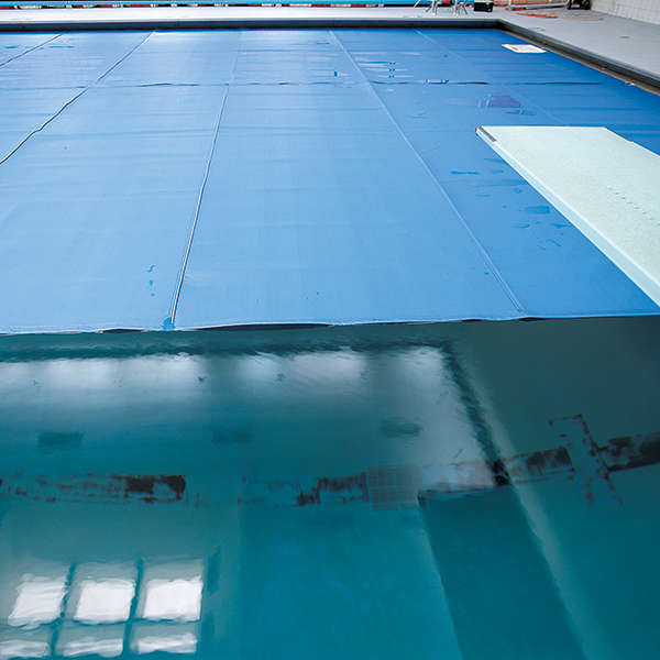 Recreonics Insulating Swimming Pool Thermal Covers with weighted or hemmed edges.