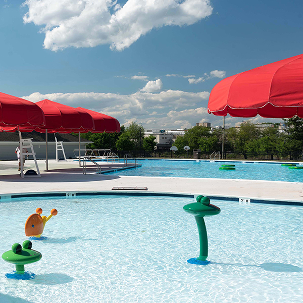 20' Funbrella Classic umbrella style shade structure with woven acrylic fabric canopy is perfect for swimming pools.