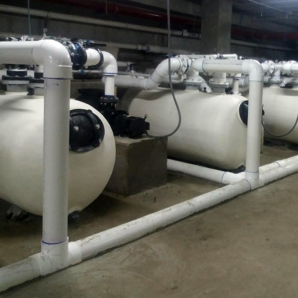 Several Pentair THS Horizontal Sand Filters hi-rate commercial swimming pool sand filters plumbed together.