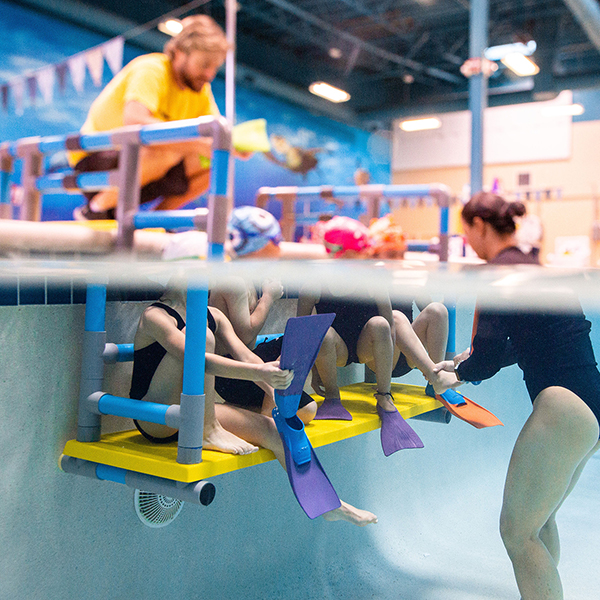 Hanging swim bench provides swim schools with a raised in-water training-teaching platform fora safe learning experience.