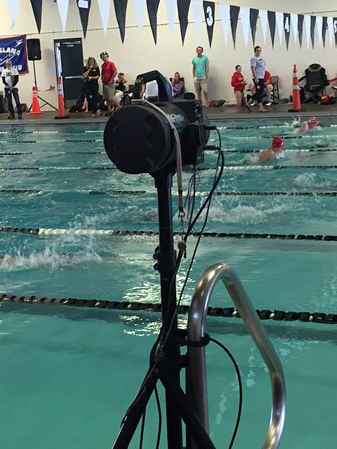Infinity Start System mounted on tripod and attached to swimming pool grab rail.